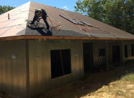 Shingles being installed