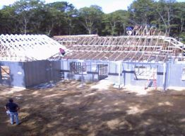 Piggyback trusses set on high roof
